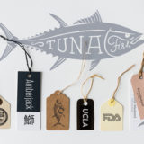Illustration of tuna with various hangtag paper labels